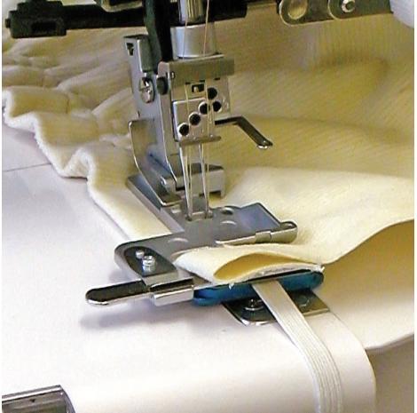 Naprężacz do wszywania gumy (8mm) do coverloków Janome, fig. 1